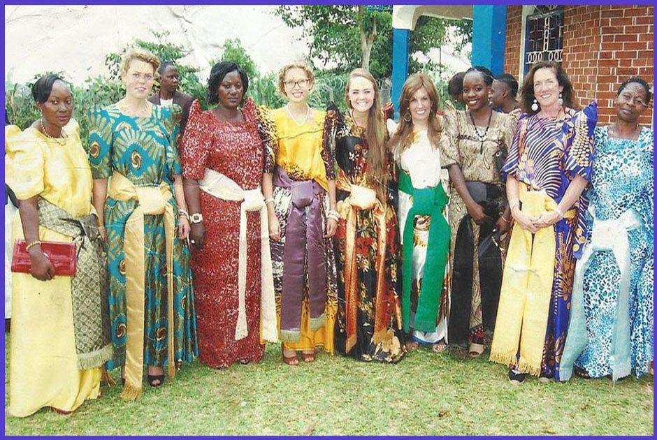 """Volunteers and Well Wishers of Volunteers for Change Uganda, attending an """"Introduction Ceremony"""" in Buganda, while wearing a traditional dress called a """"Busuuti""""."""